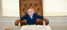Little boy in the boss' chair.